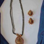 Black Bead Lakshmi Pendant Long Necklace